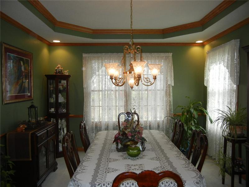 Formal dining room with double crown molding and extra lighting in all four corners of the ceiling!