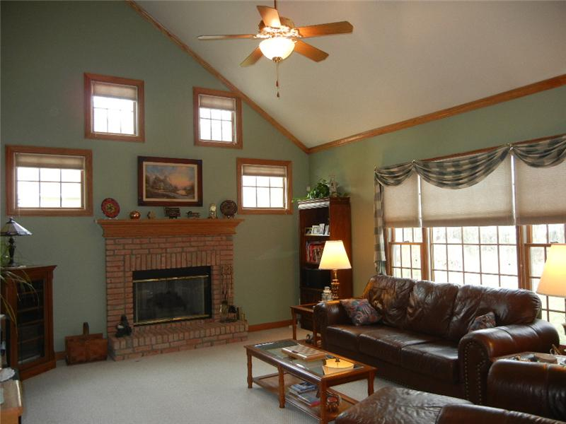 The vaulted great room overlooks the back yard and the additional windows allow for plenty of natural sunlight!