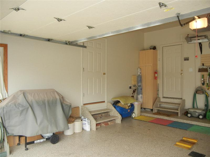 The door on the left wall leads to more storage!
