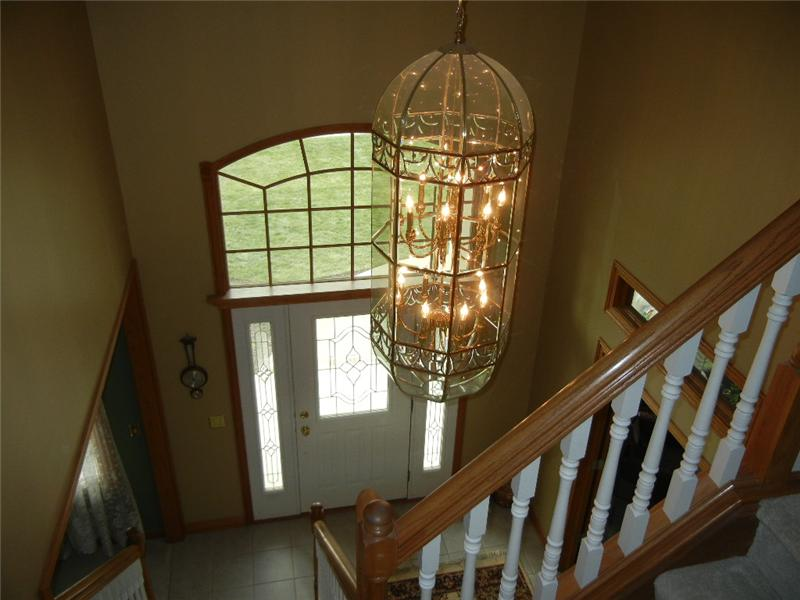 Two story foyer with ceramic tile flooring.