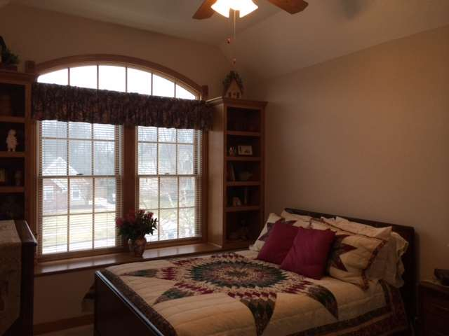 Bedroom 3 with tray ceiling, built in bookshelves and lovely, neutral decor!