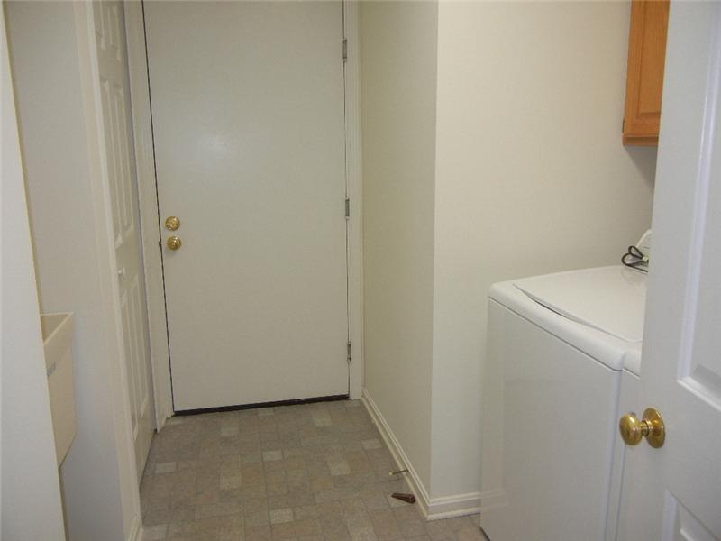 First floor laundry room includes the washer and dryer!