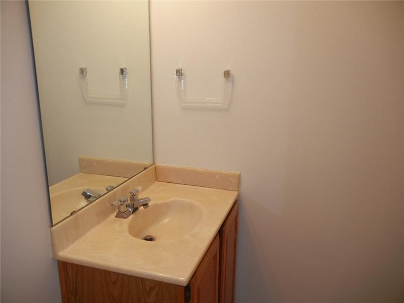 Half bath on first floor is located right off the kitchen!