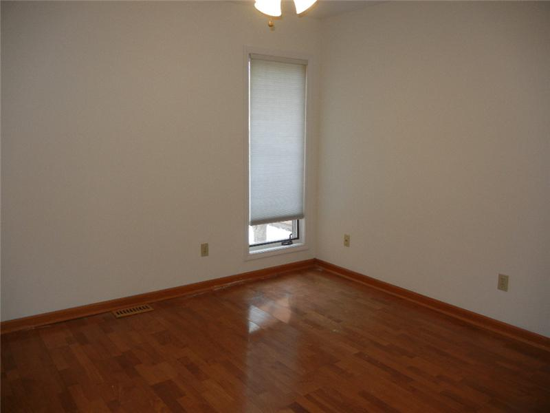 First floor office with laminate floor. This room would make a nice sitting room or second family room!