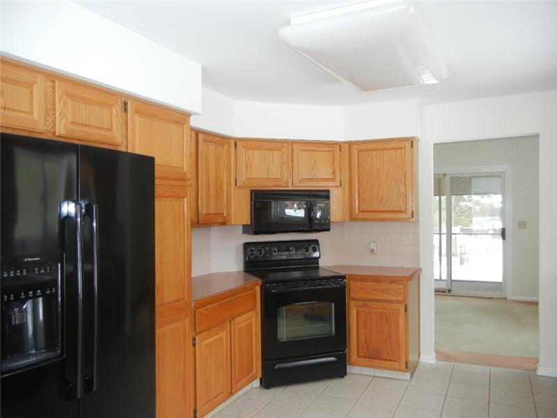 Beautiful kitchen with ceramic tile floor and all appliances included.