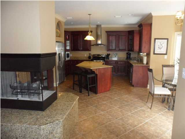Living Room and Kitchen are Open to Each Other and Separated by the Dual Opening Marble Fireplace
