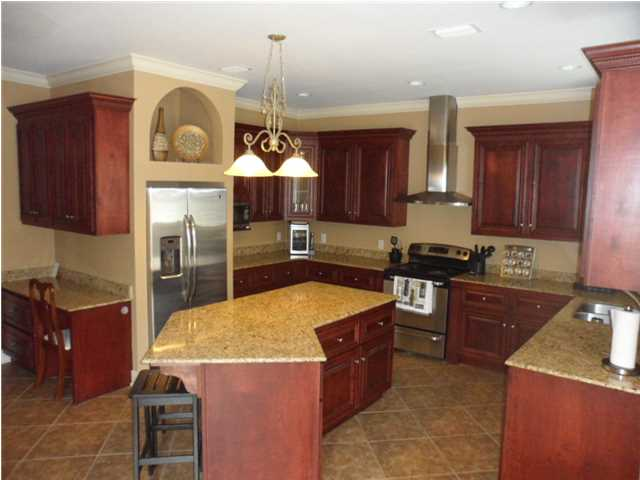 Kitchen Features Lots of Cabinets, Granite Counters, Stainless Appliances, Breakfast Bar, and Desk Area